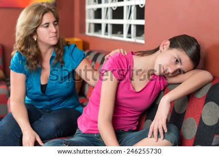 Mother tries to comfort her sad teenage daughter - stock photo