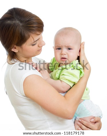 Mother trying to comfort her crying baby isolated - stock photo