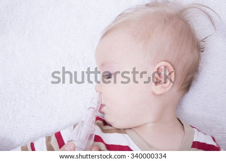 Mother using nasal aspiration for infant, mucus suction