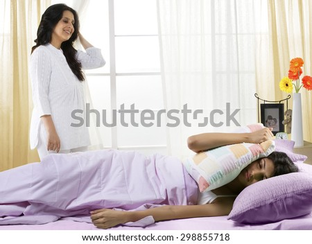 Mother waking her daughter up in the morning