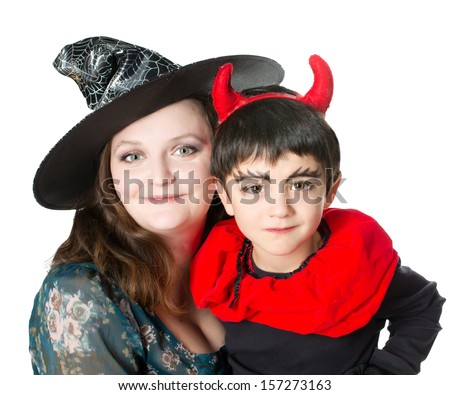 Mother wearing as witch, son wearing as devil. Halloween