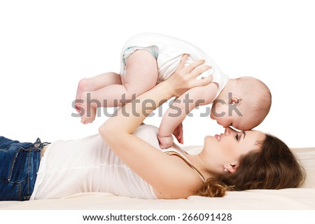 Mother with baby. A mother and baby gymnastics, yoga exercises isolated on white background. Beautiful mom with her cute baby having fun together - stock photo