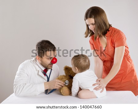 Mother with baby are having a medical visit at pediatrician doctor
