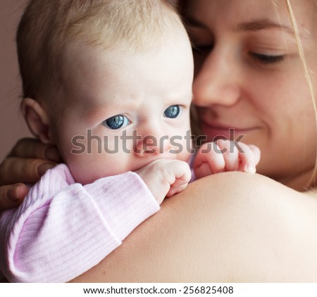Mother with baby at home. Newborn