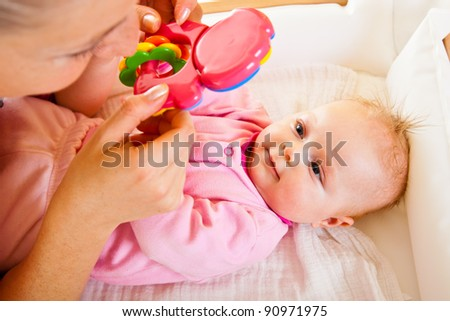 Mother with baby girl isolated on white