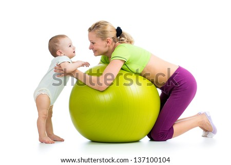 mother with baby having fun with gymnastic ball - stock photo