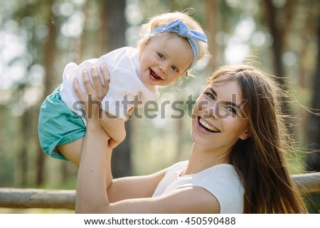 Mother with baby her little daughter play outdoor in the park - stock photo
