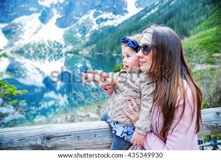 Mother with baby on family summer vacation  - stock photo