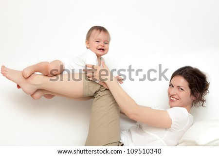 Mother with baby on white - stock photo