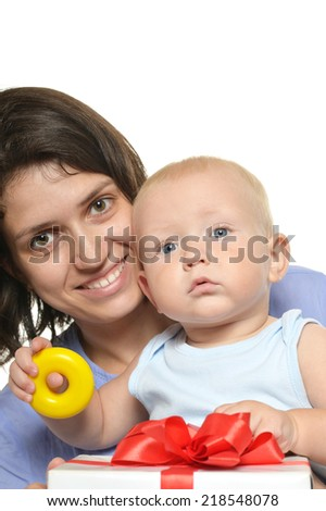 Mother with baby opening present on a white background - stock photo