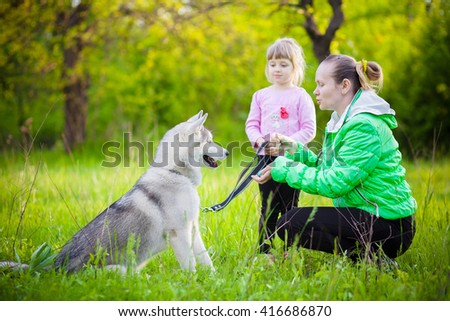 Mother with baby outdoor husky park green - stock photo