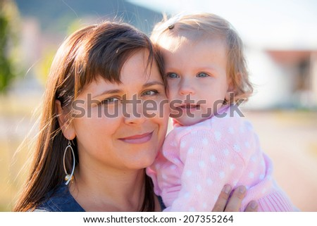 mother with child on hands