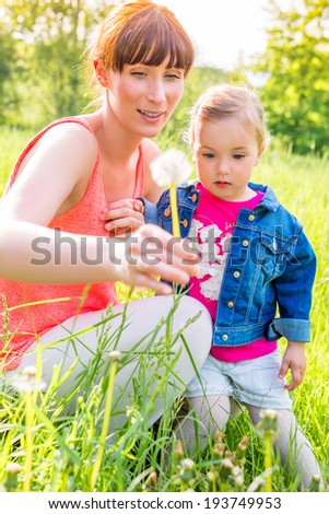 mother with child showing nature