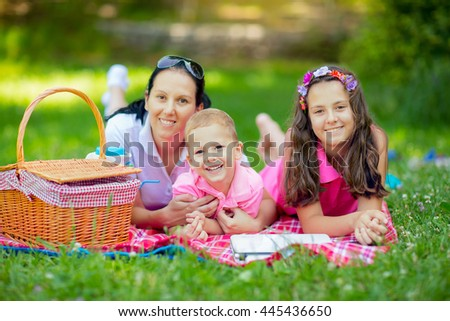 Mother with children enjoying at the picnic