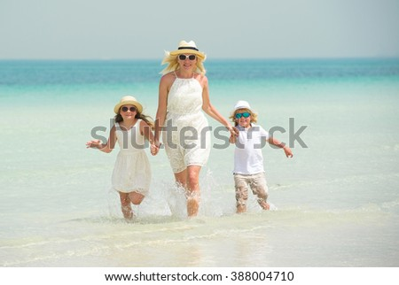 Mother with children have fun on the beach
