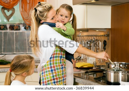 Mother with children having a lot of stress doing the homework - stock photo