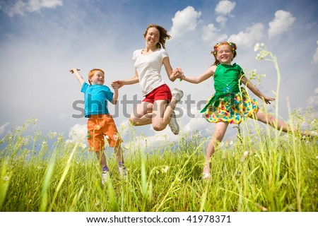 Mother with children Having Fun in the field. Foces on eyes. - stock photo