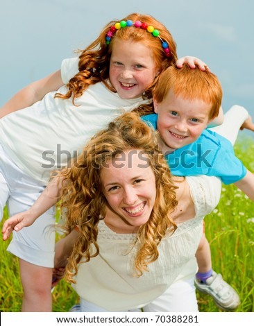 Mother with children Having Fun on field - stock photo