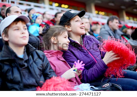 Mother with daughter and son among fans at stadium