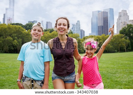 mother with daughter and son in the park - stock photo