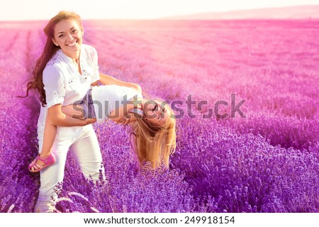 Mother with daughter on the lavender field - stock photo