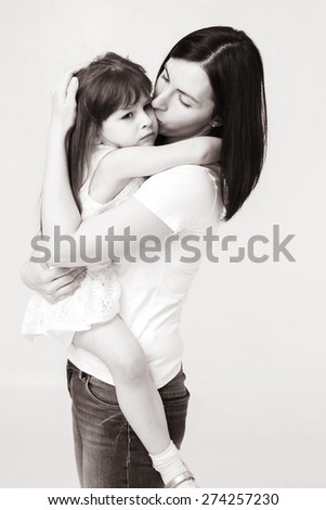 Mother with daughter portrait child black and white - stock photo