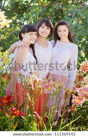 mother with daughters in garden