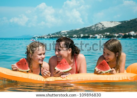 Mother with daughters in summer vacation at Adriatic Sea