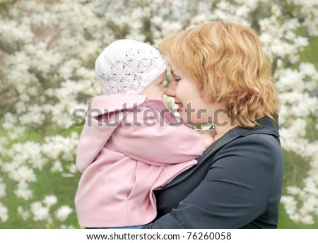 Mother with doughter in park. Happiness - stock photo