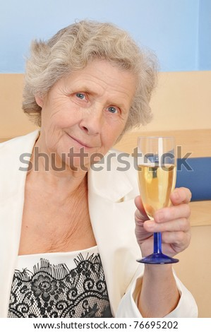 mother with goblet of champagne at home - stock photo