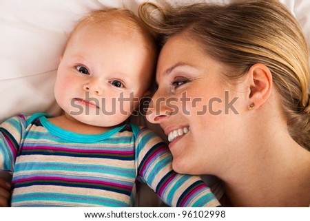 Mother with happy and cute infant baby girl