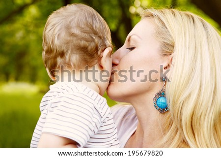 Mother with happy son - stock photo