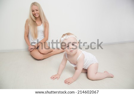 mother with her baby studio shot