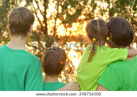 Mother with her children in park,back view - stock photo