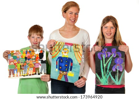 Mother with her children with childrens paintings - stock photo