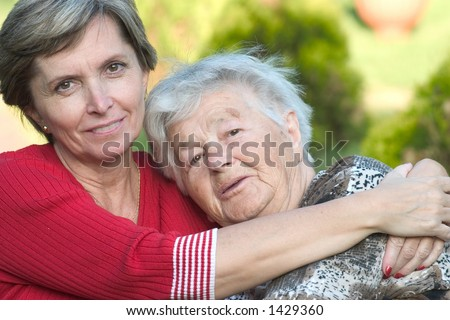 Mother with her daughter hugging each other.