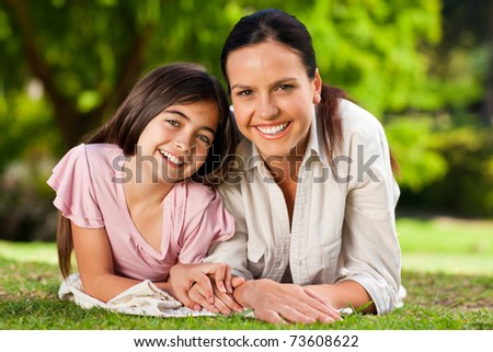 Mother with her daughter lying down - stock photo