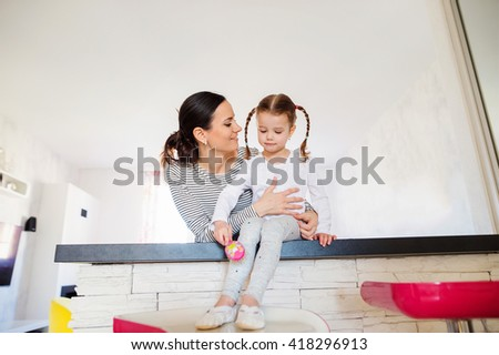 Mother with her daughter with braided hair in the morning