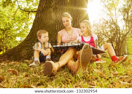 Mother with her son and daughter - stock photo