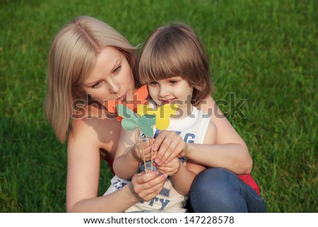 Mother with her son studing counting paper handmade paper butterflies - stock photo