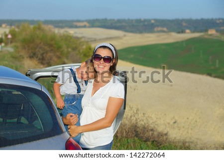 Mother with her son traveling by car. Vacations in Tuscan. Italy - stock photo