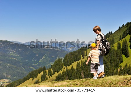mother with her son wandering high in the mountains