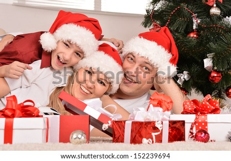 mother with her sons celebrating New Year - stock photo