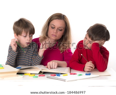 mother with her sons reading a book, partly isolated, studio shot