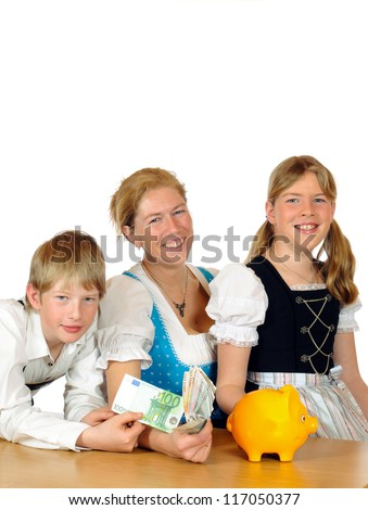 Mother with her two children and piggy bank