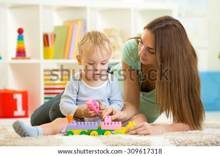mother with his child play together at home