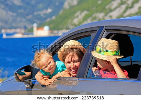 mother with kids travel by car on sea vacation - stock photo