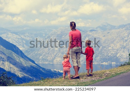 mother with kids travel in mountains vacation