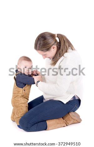 mother with little baby isolated in white