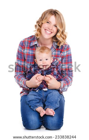 Mother with little baby isolated on white background, young beautiful mom hugging son, pretty brunet woman playing with cute small boy, smiling girl holding adorable sweet child, happy family concept - stock photo